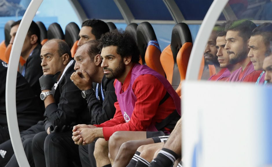 Mohamed Salah watches the Uruguay-Egypt battle from the sidelines. AP