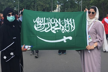 Saudi women pose with their country's flag outside the Luzhniki stadium ahead of Saudi Arabia's soccer World Cup match against Russia in Moscow on 14 June, 2018. Reuters
