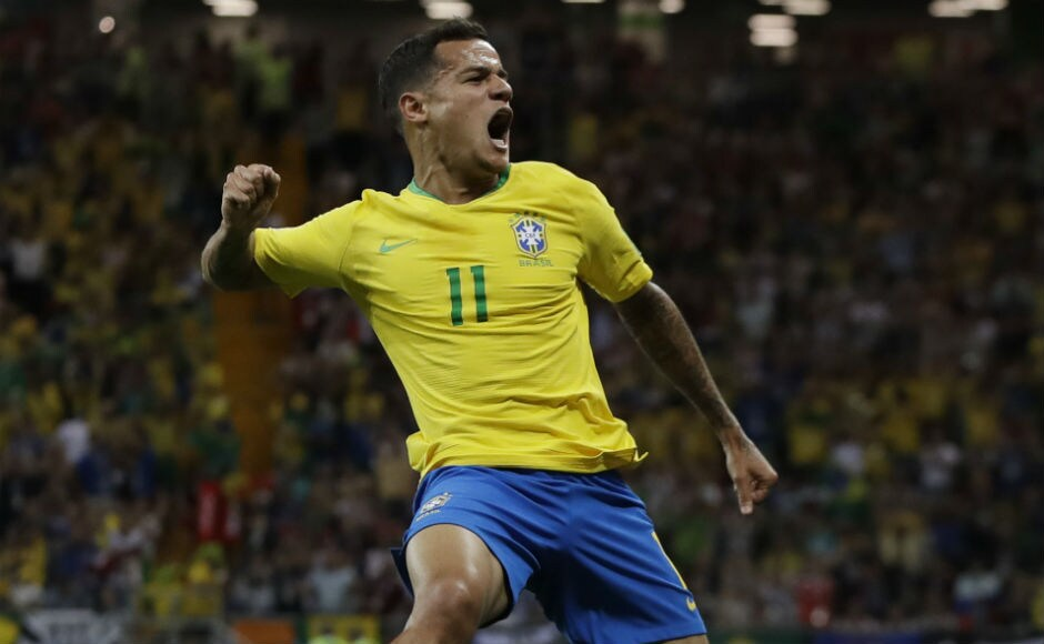 Brazil's Philippe Coutinho celebrates after scoring the opening goal of the Brazil-Switzerland clash. AP