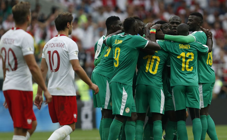 Senegal players celebrate after Poland's Thiago Cionek scored an own goal to give the Lions of Teranaga the lead. AP