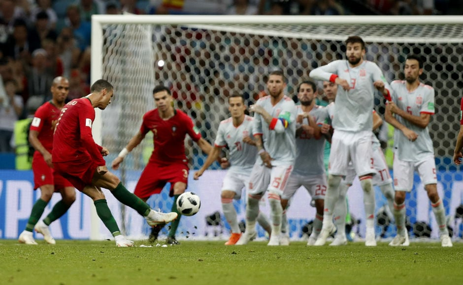 Cristiano Ronaldo takes the free kick in the 88th minute of the Portugal-Spain encounter. AP