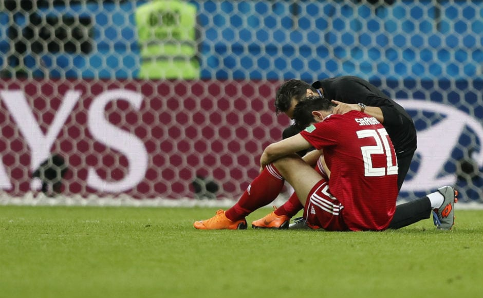Iran's Sardar Azmoun is consoled at the end of their match against Spain, which they lost narrowly by a margin of 1-0. AP