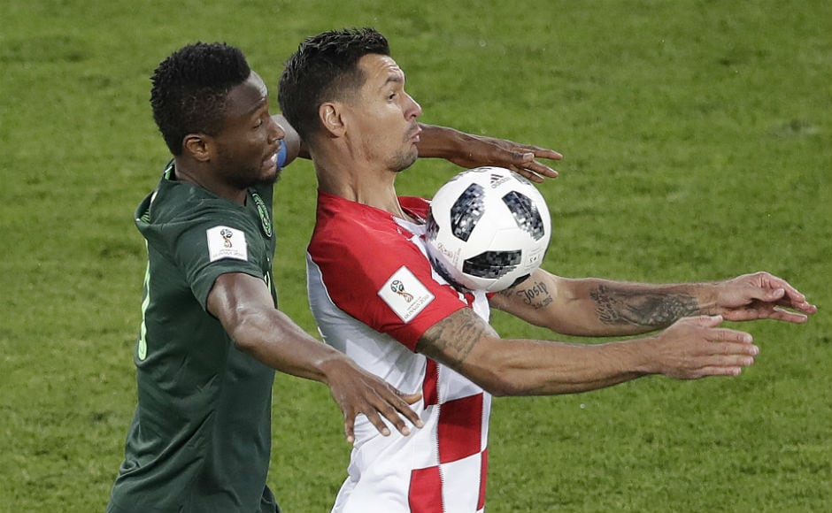 Nigeria's John Obi Mikel fights for the ball with Croatia'a Ivan Strinic. AP