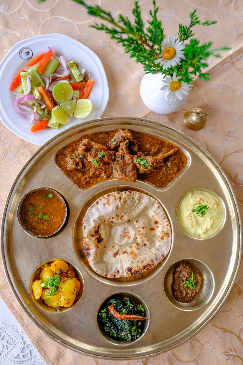 A scumptous traditional Kumaoni meal, served in centuries-old family thalis