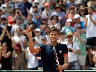 Austria's Dominic Thiem waves after defeating Greece's Stefanos Tsitsipas during their second round match of the French Open tennis tournament at the Roland Garros stadium, Thursday, May 31, 2018 in Paris. (AP Photo/Alessandra Tarantino)