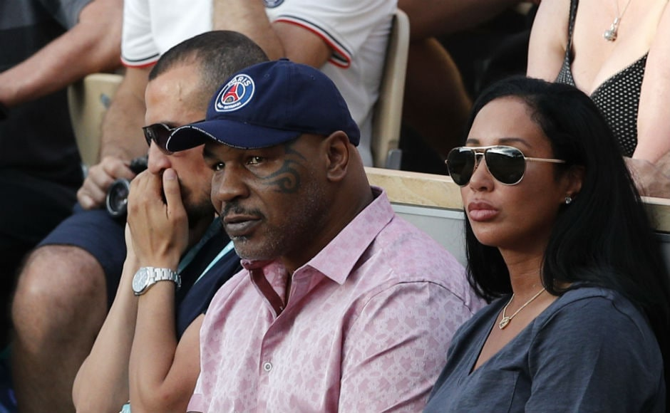 Boxing great Mike Tyson watches Serena William's match from the stands in Paris. AP