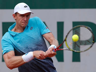 South Africa's Kevin Anderson returns the ball to Germany's Mischa Zverev during their third round match of the French Open tennis tournament at the Roland Garros stadium, Saturday, June 2, 2018 in Paris. (AP Photo/Michel Euler)