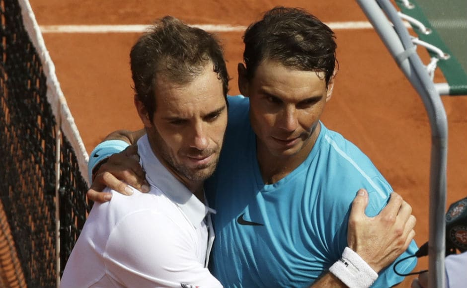 Spain's Rafael Nadal, right, hugs France's Richard Gasquet after their third round match of the French Open. AP