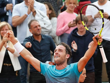 Italy's Marco Cecchinato celebrates winning his quarterfinal match of the French Open tennis tournament against Serbia's Novak Djokovic in four sets 6-3, 7-6 (7-4), 1-6, 7-6 (13-11) at the Roland Garros stadium in Paris, France, Tuesday, June 5, 2018. (AP Photo/Christophe Ena )