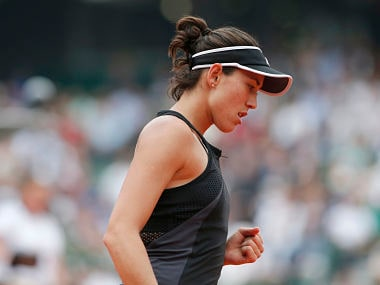 Spain's Garbine Muguruza celebrates winning her quarterfinal match of the French Open tennis tournament against Russia's Maria Sharapova in two sets 6-2, 6-1, at the Roland Garros stadium in Paris, France, Wednesday, June 6, 2018. (AP Photo/Thibault Camus)