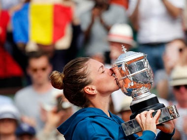 Romania's Simona Halep kisses the cup after defeating Sloane Stephens of the U.S. during their final match of the French Open tennis tournament at the Roland Garros stadium, Saturday, June 9, 2018 in Paris. Halep won 3-6, 6-4, 6-1. (AP Photo/Christophe Ena)