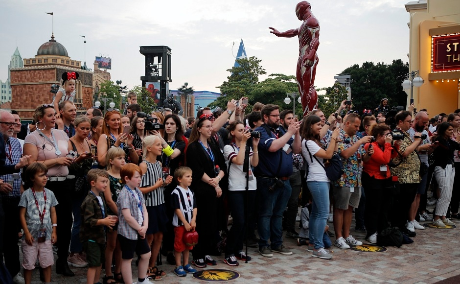 Guests take pictures at the opening show at Disneyland Paris at the launch of the first Avengers-themed season at Disneyland Paris. AP Photo/Francois Mori