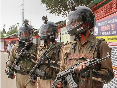 Security personnel wearing camera-equipped helmets ahead of the Amarnath Yatra. PTI
