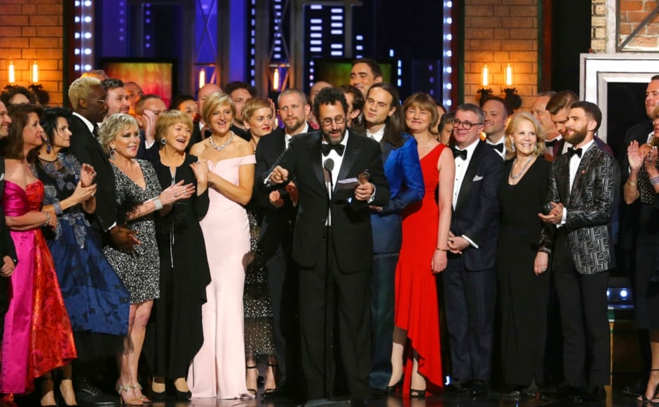 Playwright Tony Kushner and the cast and crew of Angels in America accept the award for Best Revival of a Play. AP/ Michael Zorn