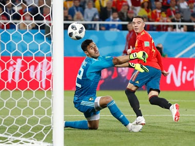 Spain's Iago Aspas, right, scores his side's second goal past Morocco goalkeeper Monir El Kajoui, during the group B match between Spain and Morocco at the 2018 soccer World Cup at the Kaliningrad Stadium in Kaliningrad, Russia, Monday, June 25, 2018. (AP Photo/Petr David Josek)