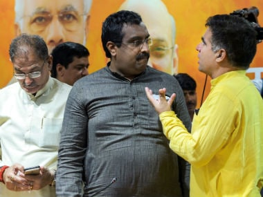 BJP in-charge for Jammu and Kashmir Ram Madhav with the state deputy chief minister Kavinder Gupta (left) and BJP state chief Ravinder Raina. PTI