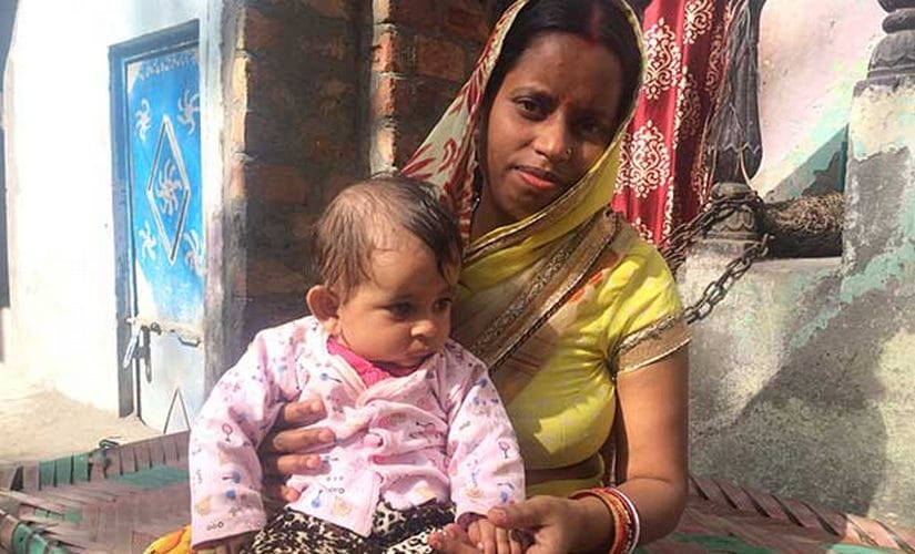 "Babita Jaiswal, 30, a mother of three, registered with mMitra during her last pregnancy. ""I am very careful of cleanliness now. I always wash my hands before feeding him,"" Jaiswal said referring to her youngest, a boy. IndiaSpend"