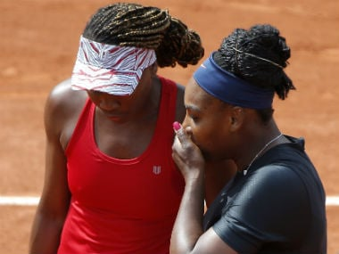 Serena Williams and her sister Venus in action against Slovenia's Andreja Klepac and Spain's Maria Jose Martinez Sanchez. AFP