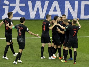 Croatia's players celebrates with teammate Ivan Perisic after scoring his side winning goal against Croatia. AP