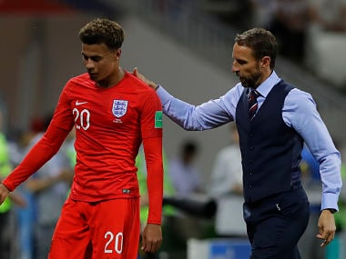 England head coach Gareth Southgate escorts Dele Alli after replacing him with Ruben Loftus-Cheek during the group G match against Tunisia. AP