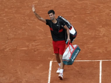 Serbia's Novak Djokovic leaves the court after losing to Italy's Marco Cecchinato after their quarter-final match. AP