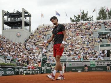 Serbia's Novak Djokovic gestures after missing a shot against Spain's Roberto Bautista Agut. AP