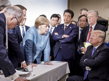 German chancellor Angela Merkel speaks with US president Donald Trump. AP
