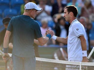 Mikhail Kukushkin (R) shakes hands with Kyle Edmund after their quarter-final match. AFP