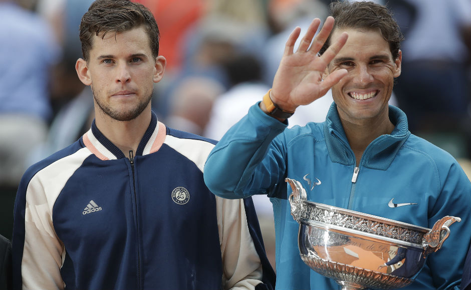 Eleven-times French Open winner Spain's Rafael Nadal, right, and runner-up Austria's Dominic Thiem hold the trophies after the men's final. AP