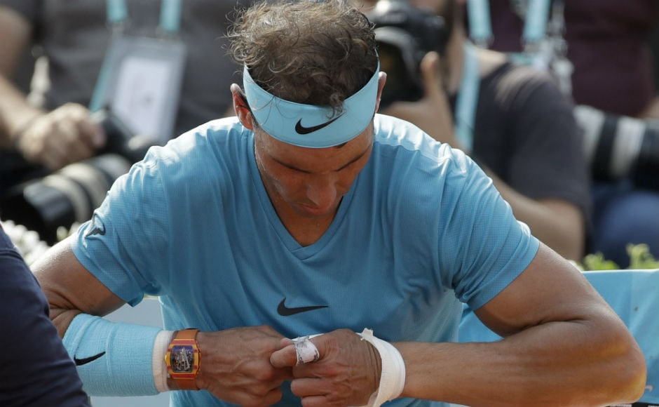 Spain's Rafael Nadal removes a bandage on his wrist in the men's final match of the French Open tennis tournament against Austria's Dominic Thiem. AP