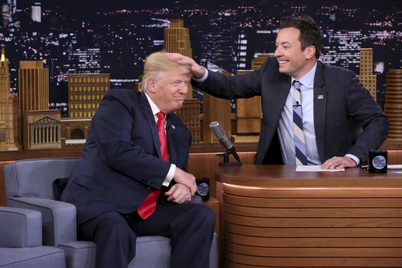 """FILE - In this Sept. 15, 2016 image originally released by NBC, Republican presidential candidate Donald Trump appears with host Jimmy Fallon during a taping of """"The Tonight Show Starring Jimmy Fallon,"""" in New York. Fallon is opening up about the personal anguish he felt following the backlash to his now-infamous hair mussing appearance with Donald Trump. Trump opponents criticized Fallon for a cringeworthy interview only weeks before the election where Fallon playfully stroked Trump's hair. (Andrew Lipovsky/NBC via AP, File)"""