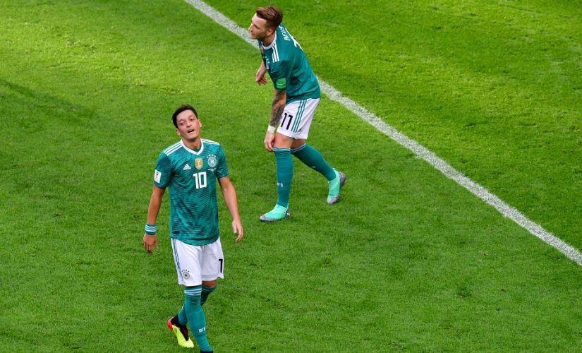 Germany's midfielder Mesut Ozil and forward Marco Reus (R) react to missed chances in the opening stages. AFP