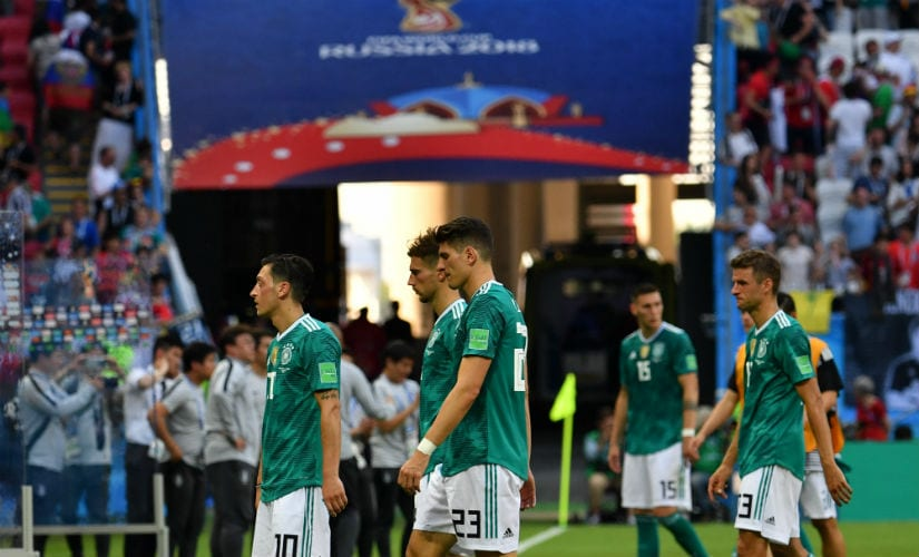 Germany's team players react at the end of the match. AFP