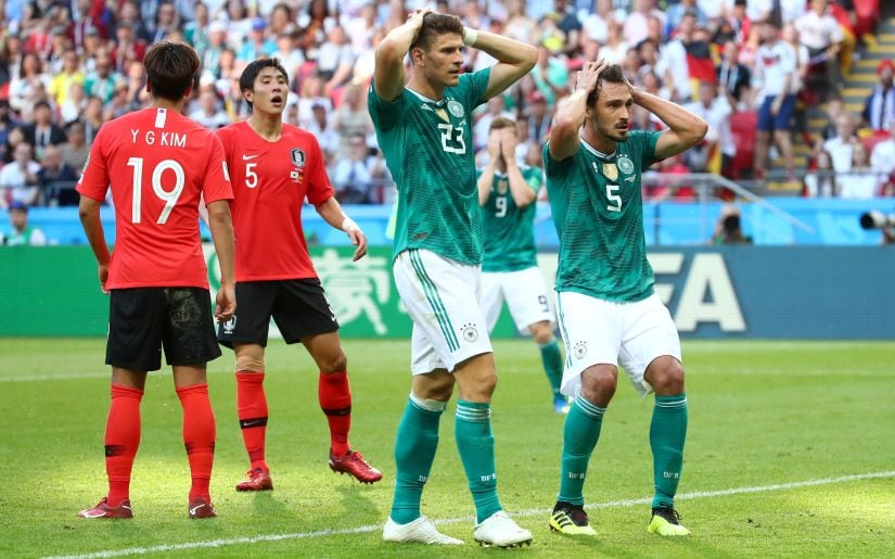 Germany's Mario Gomez and Mats Hummels react after a missed chance against South Korea at the 2018 World Cup. Reuters