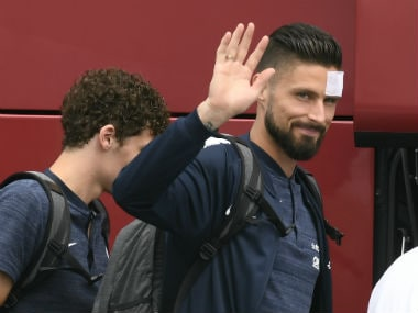 France's forward Olivier Giroud waves before taking a plane to Russia. AFP