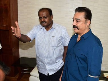 Karnataka Chief Minister HD Kumaraswamy meets MGM chief Kamal Hassan at his official residence, in Bengaluru on Monday. PTI