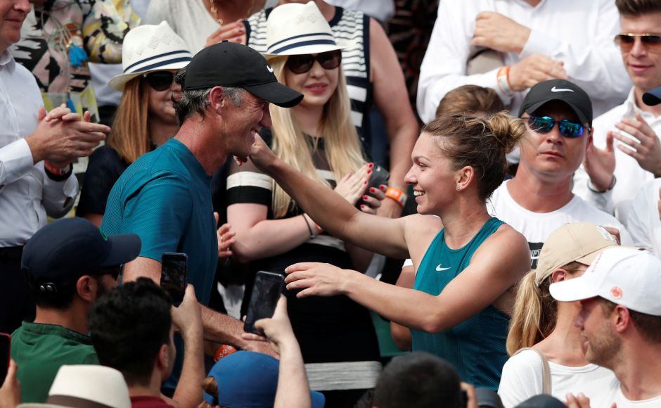 Simona Halep celebrates with her coach Darren Cahill after winning the final against Sloane Stephens. Halep climbed into the stands to embrace Romania's former Olympic gymnastics champion Nadia Comaneci and 1978 Roland Garros winner Virginia Ruzici, the last Romanian to win a Grand Slam title. Reuters