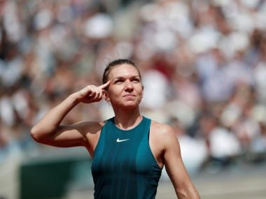 Simona Halep celebrates winning her quarter final match against Angelique Kerber. Reuters