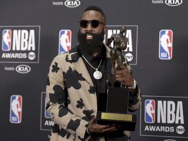James Harden, of the Houston Rockets, poses  with the Most Valuable Player award. AP