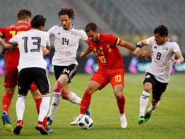 Belgium's Eden Hazard in action with Egypt's Tarek Hamed and Ramadan Sobhi. Reuters