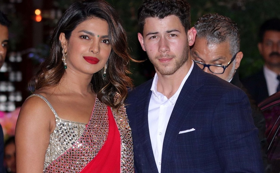 Looking stunning in red, Priyanka Chopra attended the party with American singer Nick Jonas. Firstpost Photo/Sachin Gokhale