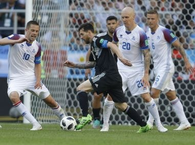 Argentina's Lionel Messi kicks the ball as Iceland's Gylfi Sigurdsson, left, tries to stop him. AP