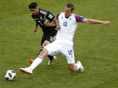 Iceland's Gylfi Sigurdsson and Argentina's Ever Banega compete for the ball during the Group D match. AP