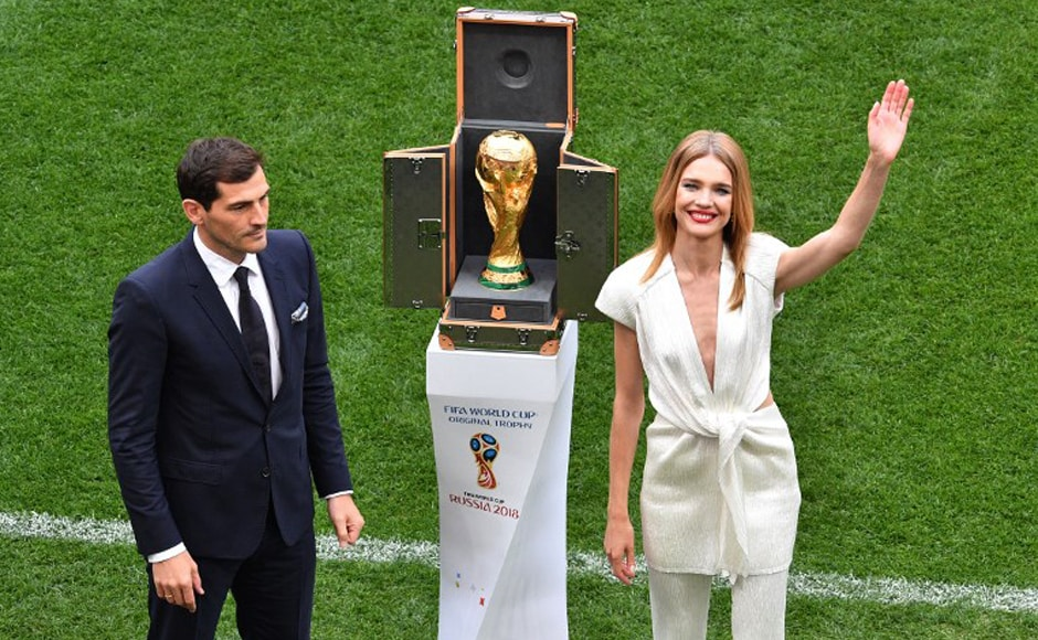 Russian model Natalia Vodianova and former Spanish goalkeeper Iker Casillas stand next to the World Cup trophy during the opening ceremony before the Russia 2018 World Cup Group A football match between Russia and Saudi Arabia at the Luzhniki Stadium in Moscow on 14 June, 2018. AFP