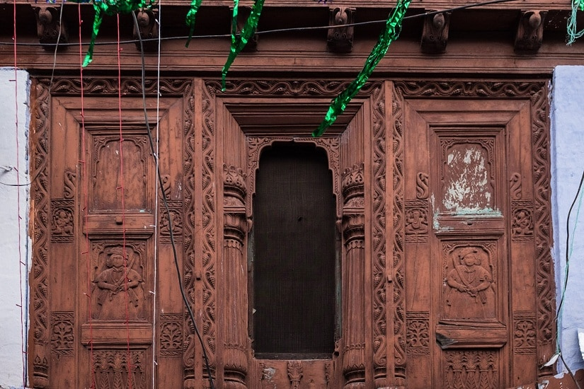 Intricately carved windows in the Almora marketplace