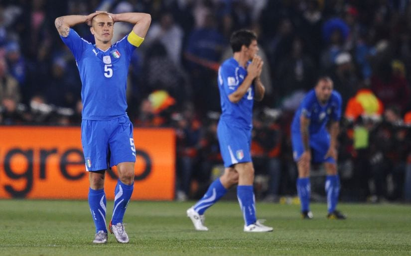 Italy's Fabio Cannavaro (L) looks dejected at the end of the Slovakia match after failing to qualify for the second round in the 2002 World Cup. Reuters