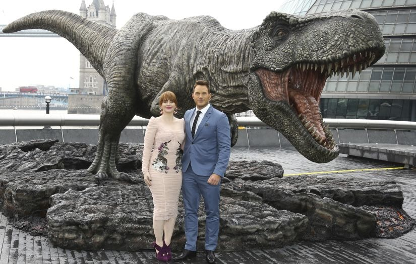 Actors Chris Pratt, right, and Bryce Dallas Howard pose for photographers at the photo call for the film 'Jurassic World: Fallen Kingdom', in central London, Thursday, May 24, 2018. (Photo by Joel C Ryan/Invision/AP)