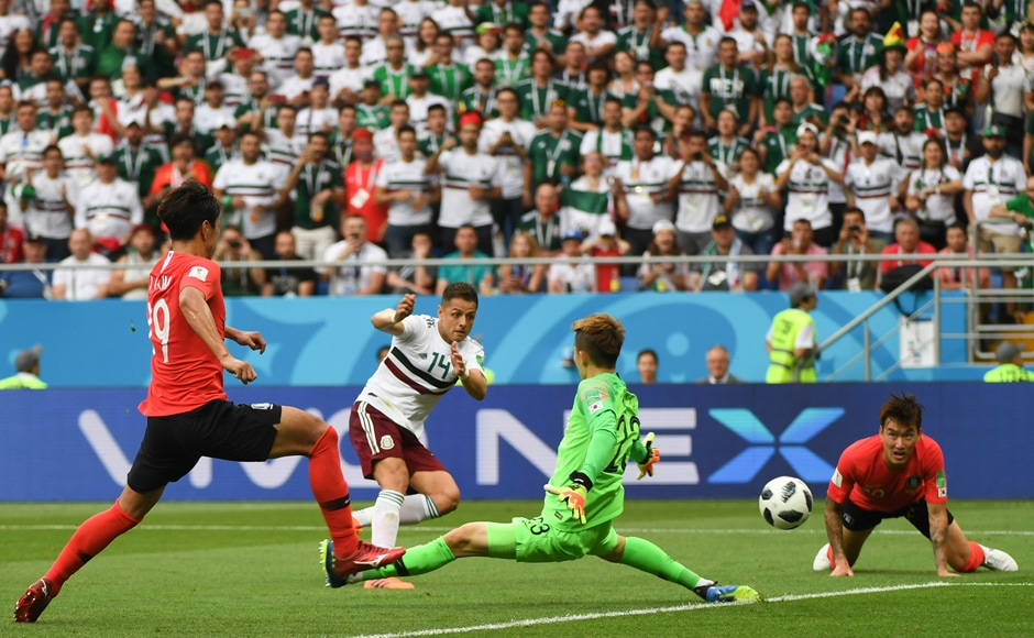 Javier Hernandez scored Mexico's second goal in their match against South Korea. Mexico won 2-1, ensuring their qualification after beating defending champions Germany in their first match. AFP