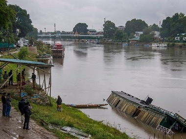 A houseboat capsizes during heavy rains in Srinagar. PTI