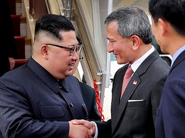 North Korean leader Kim Jong-un greeted by Singapore minister for foreign affairs. AP